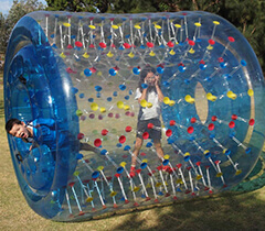 2 Children Playing in Giant Inflatable Water Roller