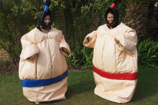 2 Girls in Inflatable Adult Sumo Suits