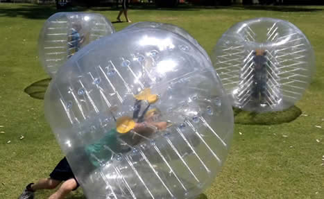 3 Children Playing in Inflatable Zorb Balls