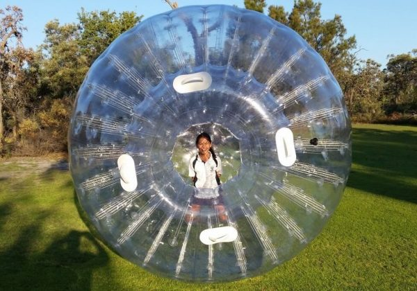 Girl Playing in Inflatable Zorb Ball