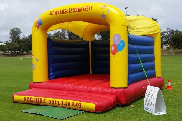 Jumpin Fun Inflatable Bouncy Castle Setup on Grass
