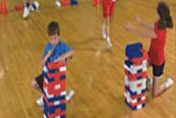 Children Playing With Premium Tumbling Blocks in a Gym