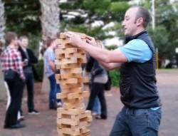 Man Playing With Hi Tower Block Game