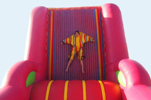 Person Attached to Red Inflatable Velcro Fly Wall
