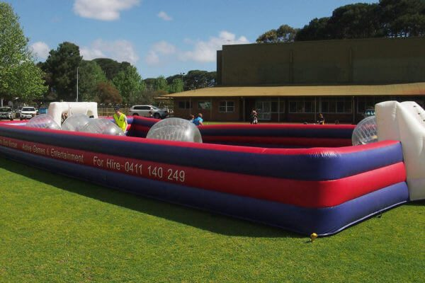 4 Zorb Balls and Referee in Bubble Soccer Arena Setup on Grass