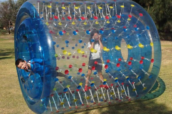 2 Children Playing in Inflatable Water Roller