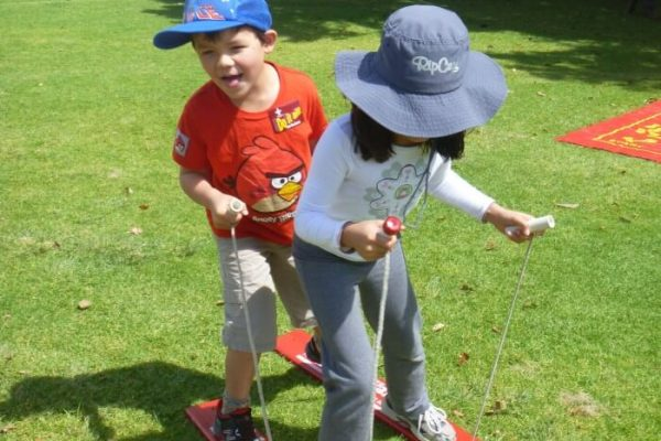 2 Children Using 2 Person Buddy Walker at Park
