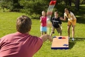 Family Playing Bean Bag Toss in Park