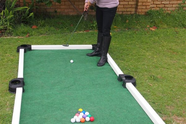 Girl Playing Golf Pool in Garden