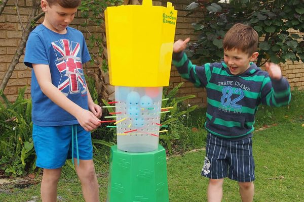 2 Children Playing Cannon Ball Drop in Garden