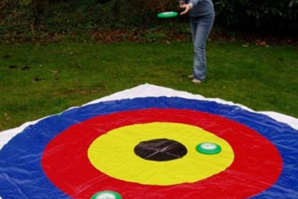 Person Throwing Disc Onto On Target Mat