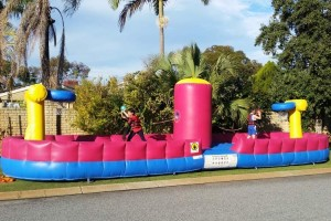 2 Children Playing on Inflatable Bungee Slam Dunk