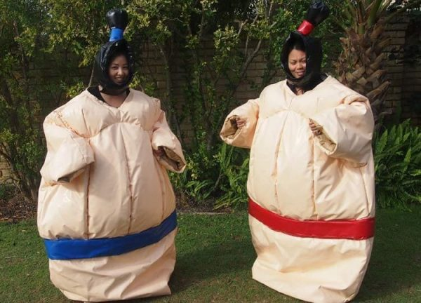 2 People Wearing Inflatable Sumo Suits