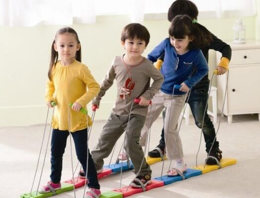 4 Children Using 4 Person Team Walker Inside