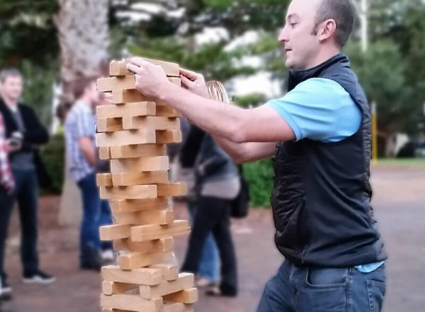 Man in Jacket Playing Hi Tower Blocks Game