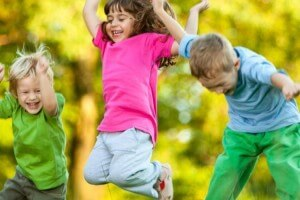 3 Children Jumping for Joy