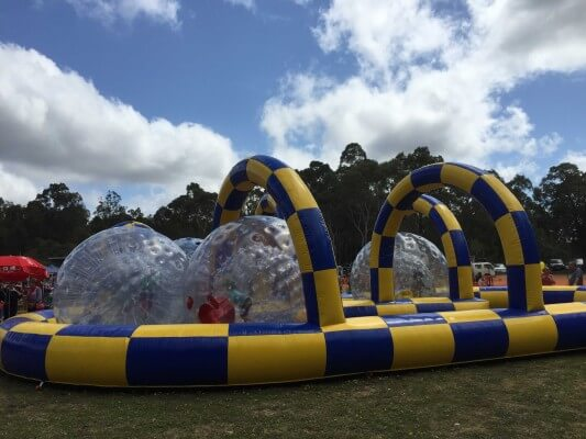 4 Zorb Balls in Zorb Ball Arena Setup on Grass Oval