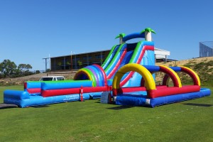 2 Lane Inflatable Water Slide Next To Slip n Slide On Grass Oval
