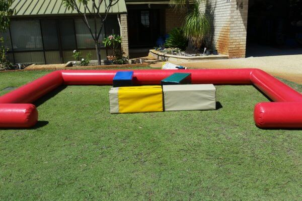 Inflatable Red Toddler Play Pen on Grass