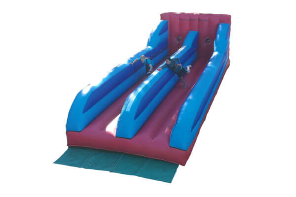 2 People Competing on 2 Lane Inflatable Bungee Run