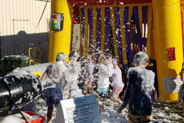 Children Playing in Bubble Wash